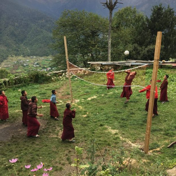 Young monks playing volleyball